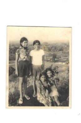 Me my sis are both wearing outfits made by hand by my mother